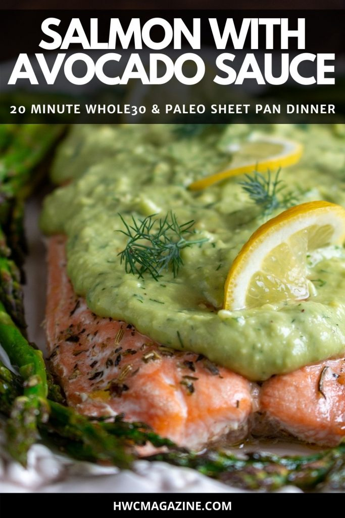 Close up shot of creamy dill avocado sauce slathered over a cooked salmon fillet.