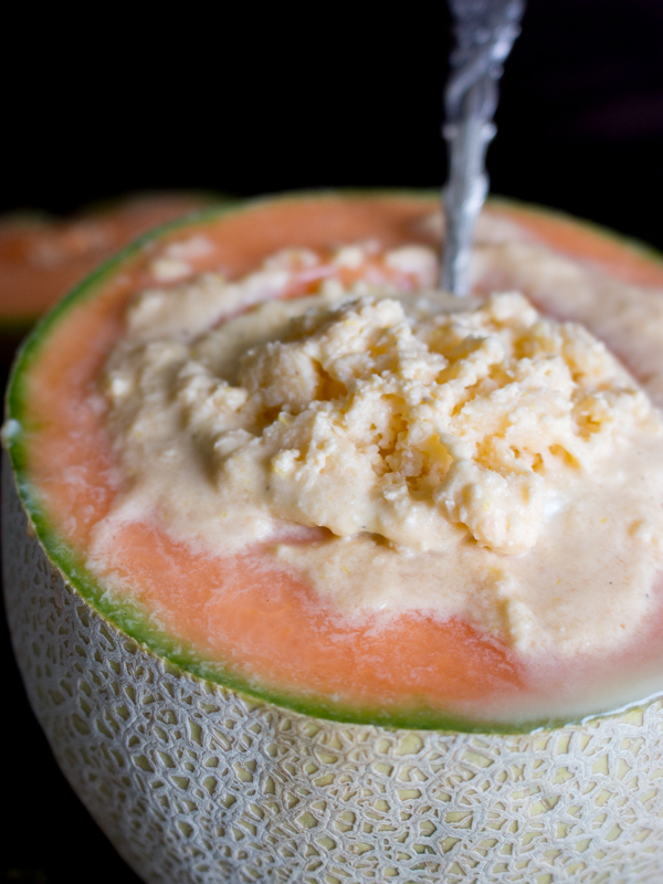 Spoon in a serving of sorbet inside half of a cantaloupe