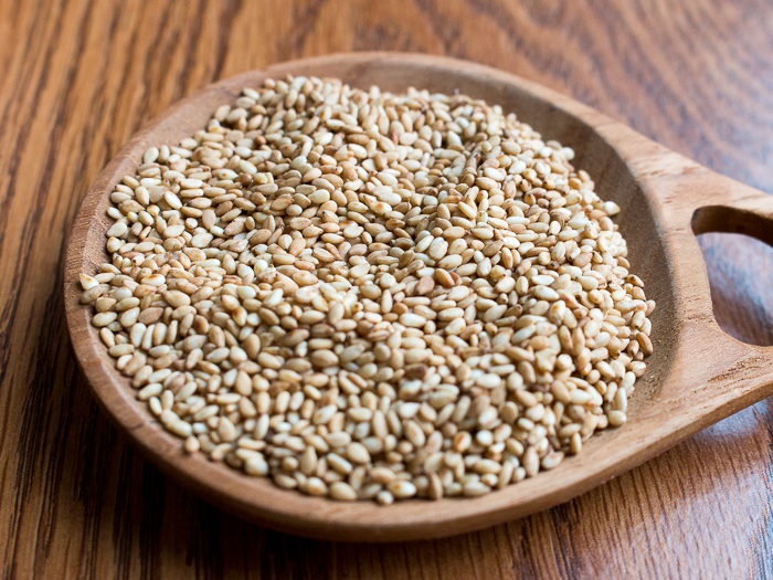Toasted white sesame seeds in wooden bowl