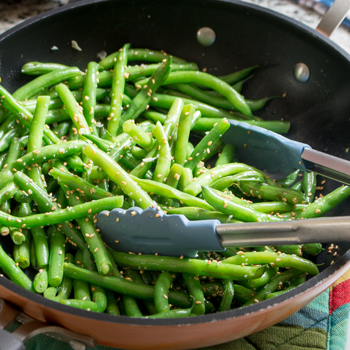 Green Beans and Sesame seeds stir frying in pan