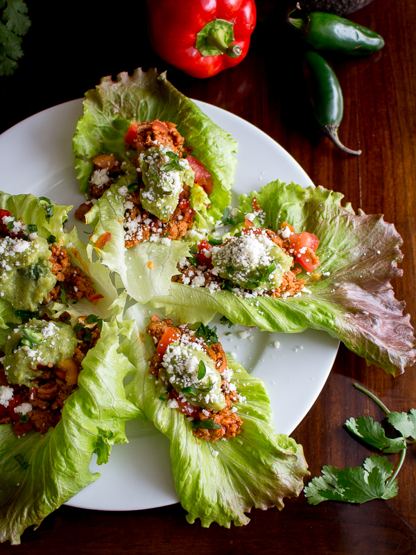 Top down photo of 5 turkey taco lettuce wraps with jalapeno and