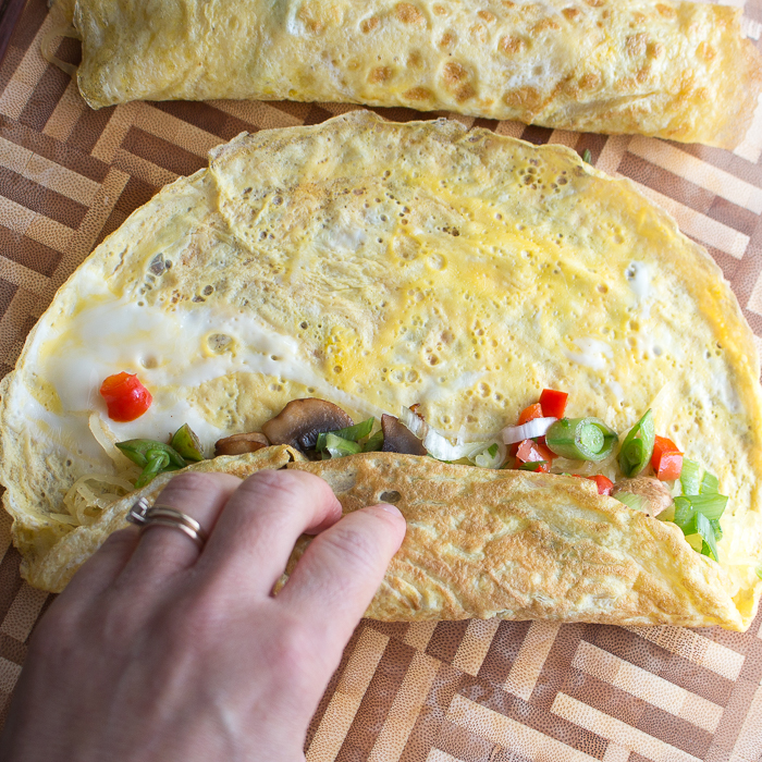 rolling up our skinny spaghetti squash egg roll ups like a burrito