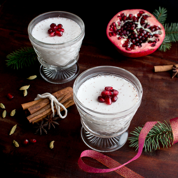 Spicy Chai Coconut Jelly in a holiday scene with red ribbon, cinnamon sticks, and evergreen