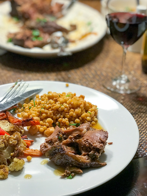 Leg of lamb meal served with red wine