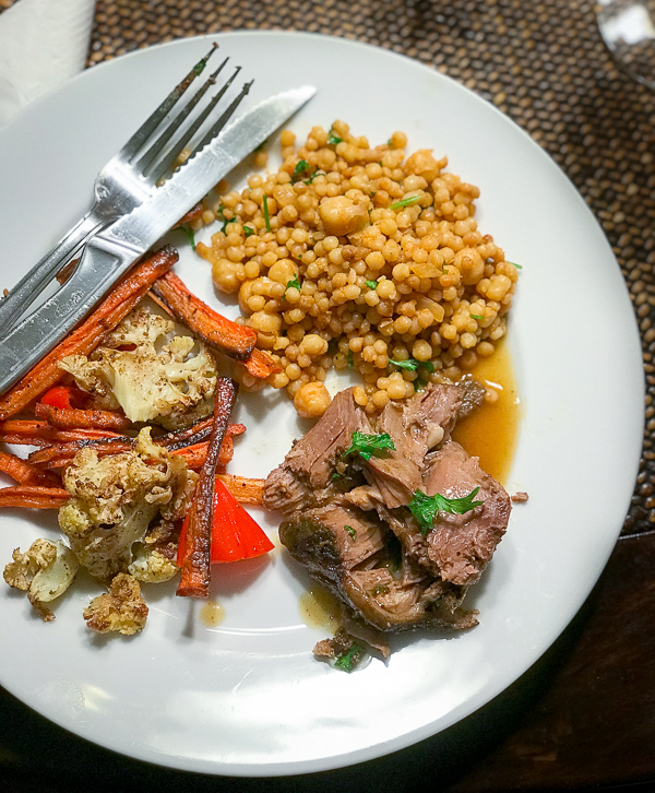 leg of lamb served with roasted veggies and Israeli Couscous