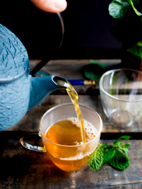 Hot Moroccan Mint Tea getting poured into cups