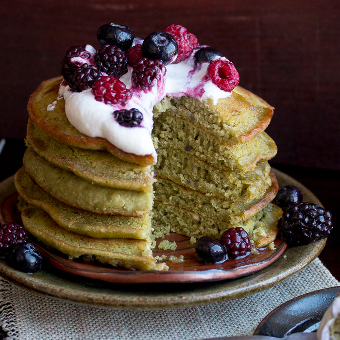 Stack of 5 pancakes cut into showing the green matcha.