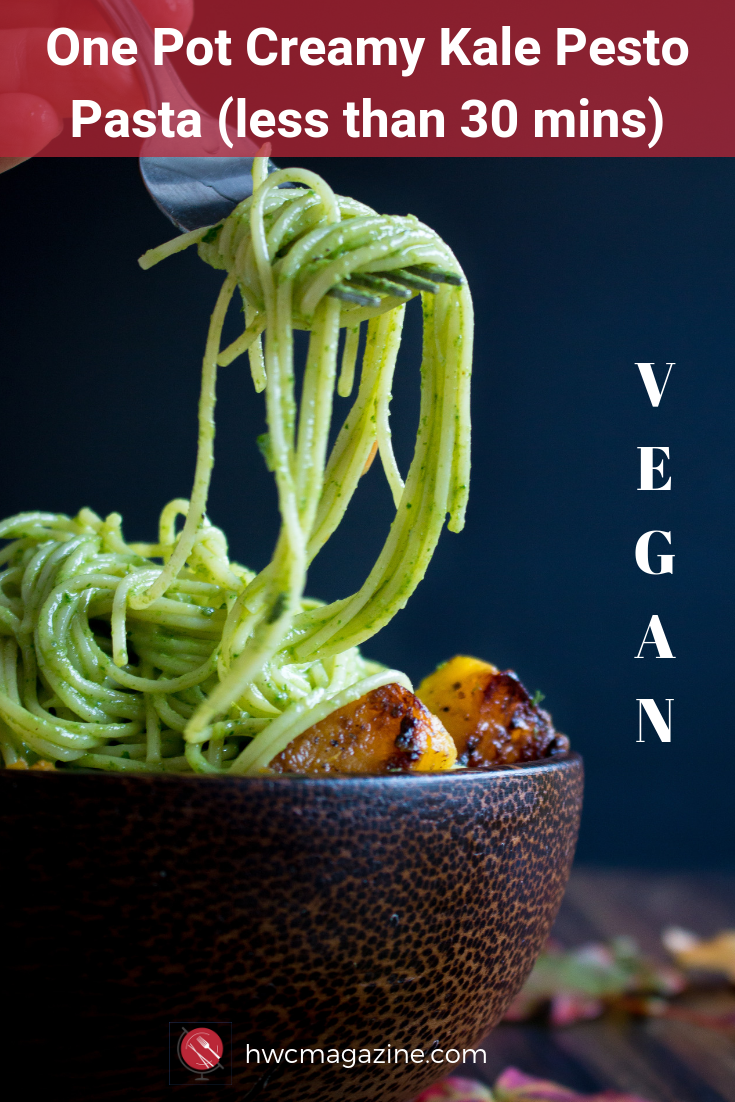 One Pot Creamy Kale Pesto Pasta is an easy way to get dinner on your table in under 30 minutes. Angel hair pasta noodles are tossed with a kale pepitas pesto and pan fried acorn squash. Everything is cooked in one pot! #pasta #noodleswithoutborders #pesto #kale #acorn #squash #vegan #easy #falldinneridea/ https://www.hwcmagazine.com