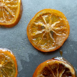 Honey Candied Meyer Lemon Slices on a baking sheet drying.