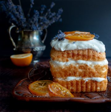 Icebox Lavender Lemon Angel Food Cake topped with beautiful honey candied meyer lemons and fresh lavender in the background.
