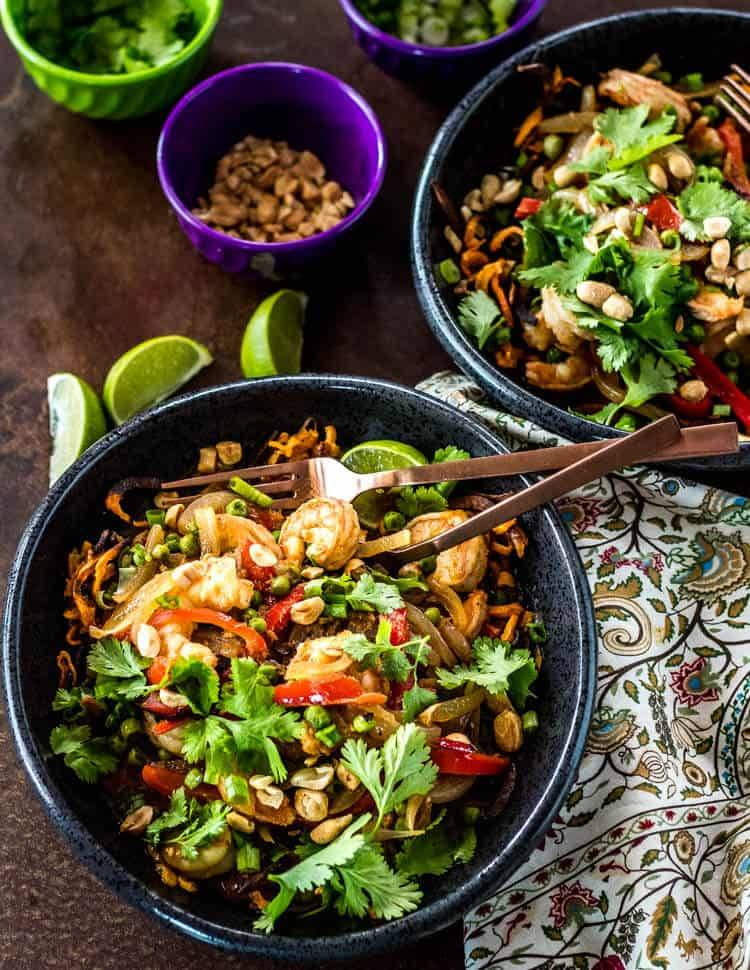 Thai Sweet Potato Bowls with shrimp and peas, garnished with limes and cilantro