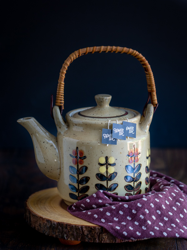 Tea pot steeping with Fraser Tea sachets.