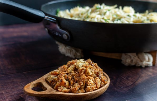 Bowl of homemade Bread Crumbs Next to a skillet of freshly made pasta.