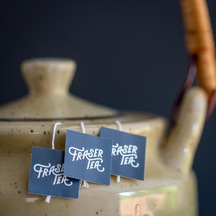 Fraser Tea sachets brewing in a tea pot.