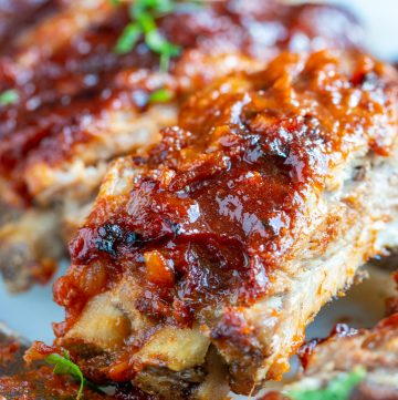 Stack of juicy ribs with the date bbq sauce slathered on top.