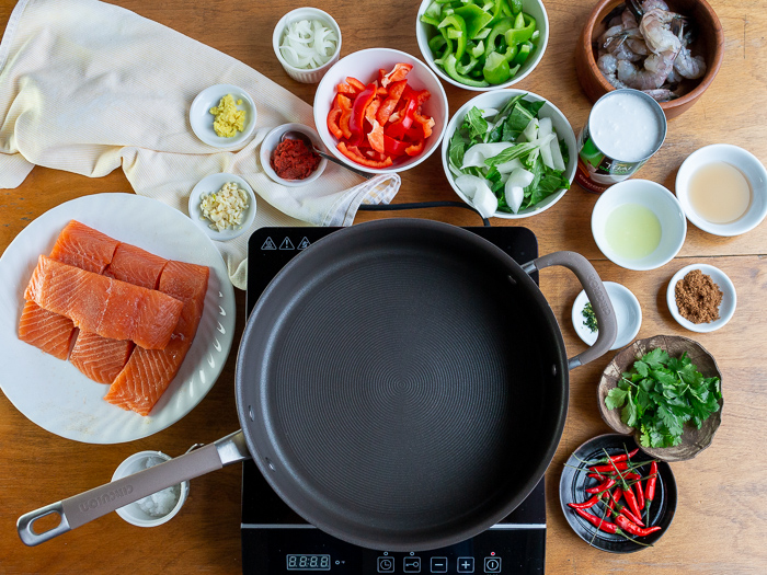 All the Recipe ingredients mise en place around the black pan on top of a burner.