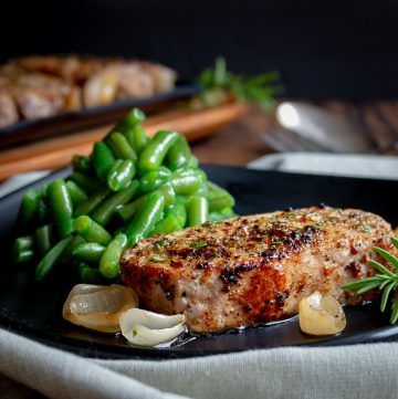 Rosemary Pork chops on a black plate with green beans. Please click on the button below 30 minute meals to go to the 30 minute meal category for more recipes.