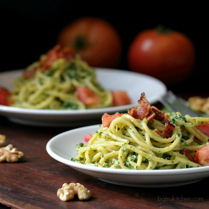 Speedy Spinach Pasta bowls topped with tomatoes and bacon.