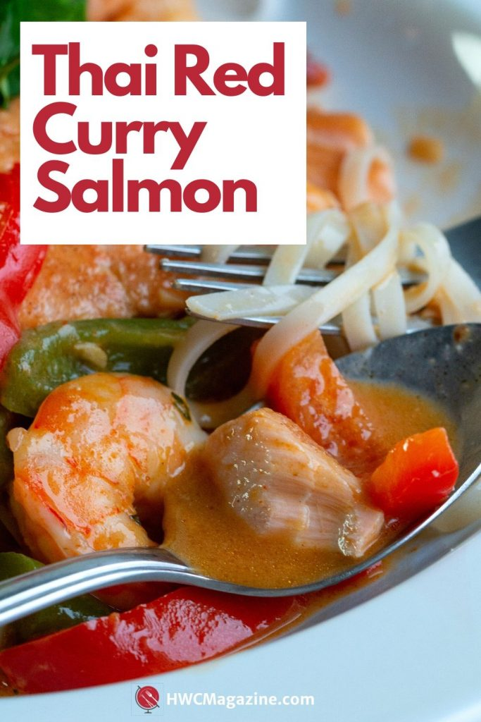 Bowl of thai Red curry salmon with delicious coconut broth in a white bowl with noodles tossed around.