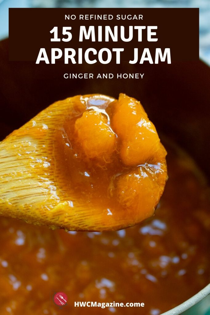 Dollop of apricot jam on a wooden spoon.