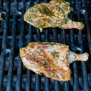 Cornish hens on the grill skin side down.