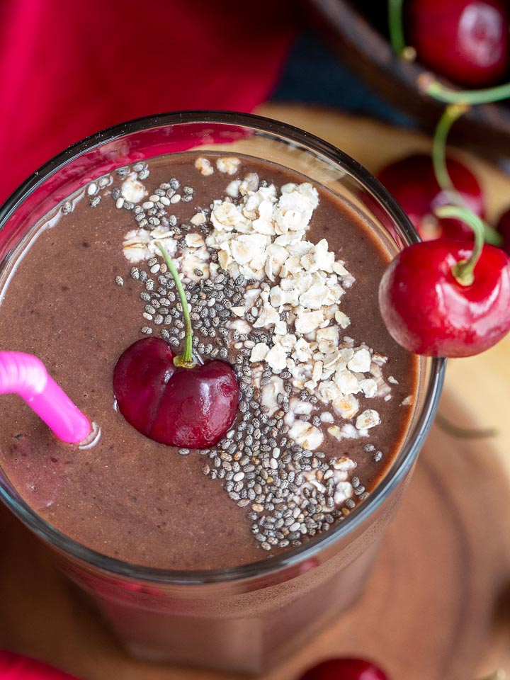 Up close shot of smoothie with all the garnishes on top.