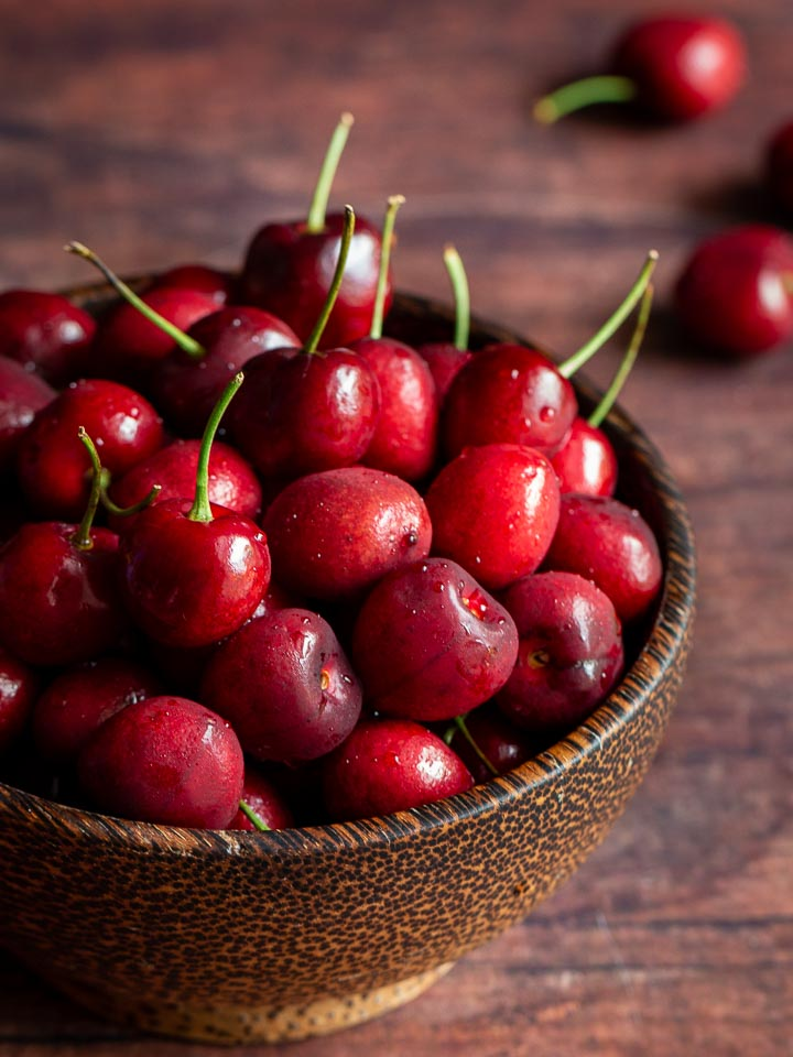 Cherries in a wooden bowl.